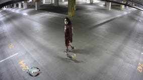 Seattle Police asking for help to identify 'person of interest' in parking garage car theft case