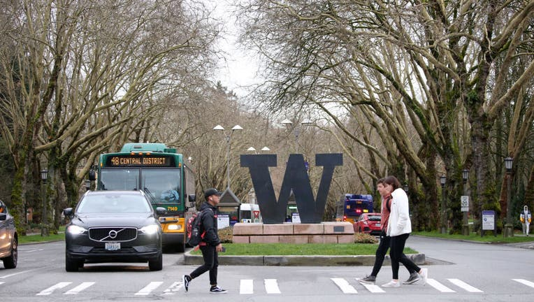 FILE - Students at the University of Washington are on campus for the last day of in-person classes.