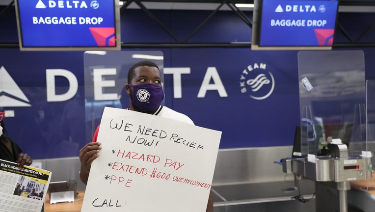 d3a0b365-Unemployed Airport Workers Call On Delta To Rehire After Airline Received Bailout
