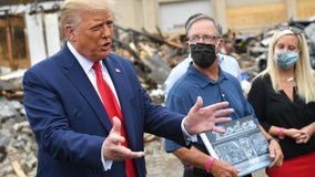 Owner of burned business accuses Trump of misleading public