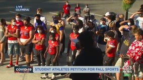 Student-athletes march to Washington state capitol for fall sports