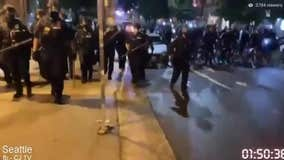 Seattle protests: Officer hit with baseball bat; another police officer ran over a man with his bicycle