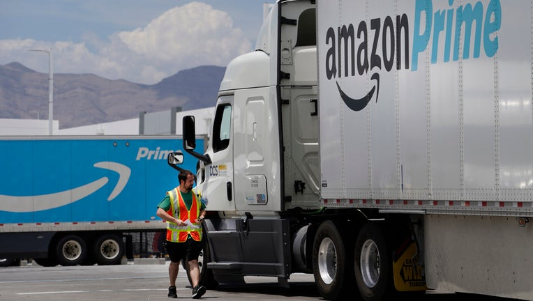 A security guard check in an Amazon truck at the Amazon regional distribution center on June 6, 2019 in Las Vegas, Nevada.