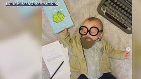 While newborn naps, mom costumes her for Halloween