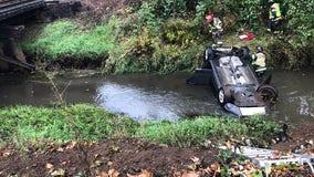 Police: Car reported stolen found upside-down in Renton creek