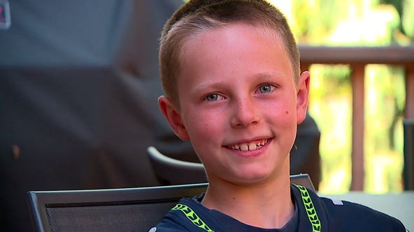 Seahawks huddle around Mercer Island boy who beat cancer