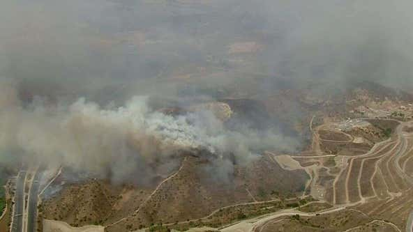 Fast-moving wildfire forces evacuation of over 90,000 in Southern California
