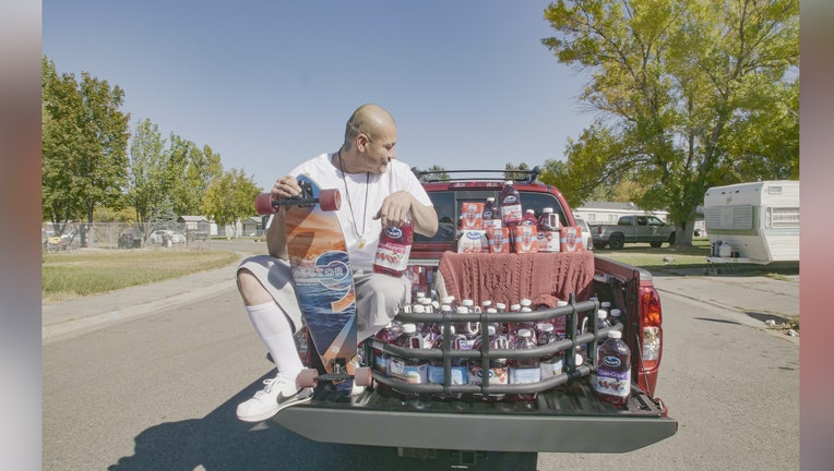 Nathan Apodaca with his new truck and cranberry juice gifted by Ocean Spray.