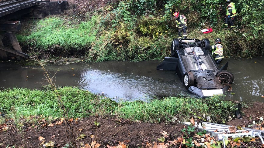 Police: Car reported stolen found upside-down in Renton creek