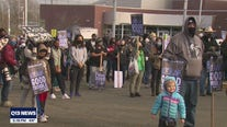 Crowds wear masks to march in Seattle honoring legacy of Dr. Martin Luther King Jr.