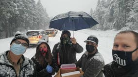 Oregon health workers stuck in snow give other drivers COVID-19 vaccine