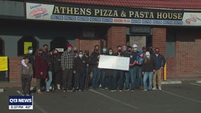 Local firefighters present $1000 check to help beloved restaurant that burned in a fire