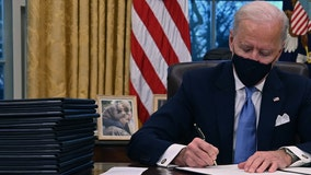 With photo of late son Beau behind him, President Joe Biden begins work at White House