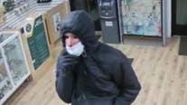 Help ID creepy crook seen wearing Halloween mask to rob pot shop clerk at gunpoint