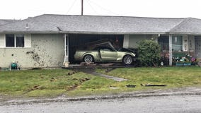 Car crashes into Parkland home, trapping man inside his living room