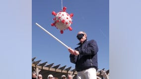 Beating COVID-19: Senior citizens take swing at virus-shaped piñata after getting vaccinated