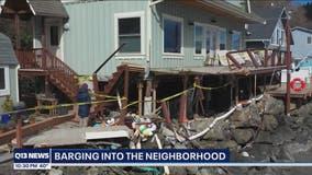 USCG: Tug pilot fell asleep before barge hits three homes in Gig Harbor