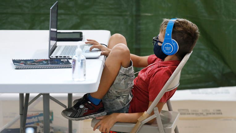 FILE - A third grade student sits during his online class from his social distanced desk on Sept. 3, 2020 in Los Angeles, California. (Photo: Al Seib / Los Angeles Times via Getty Images)