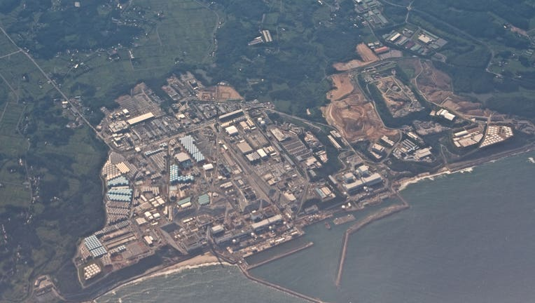 7f0e32c8-Fukushima Daiichi Nuclear Power Station daytime aerial view from airplane