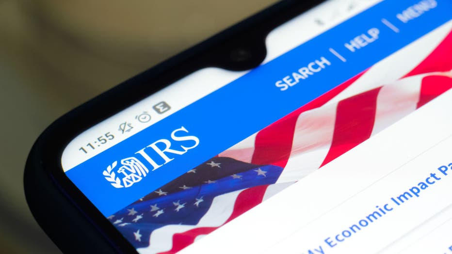 4c030ae0-In this photo illustration the Internal Revenue Service (IRS