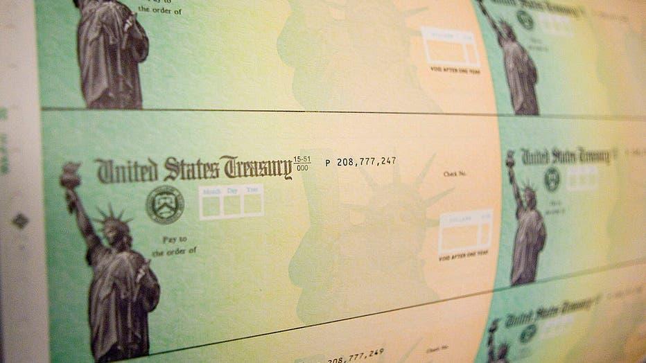 a16a5a18-Economic Stimulus Package Tax Rebate Checks Printed