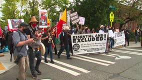 Demonstrators march in solidarity for immigrant workers in Seattle on May Day