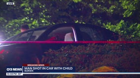 Man shot in car with child inside