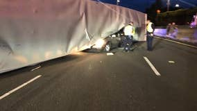 Semi overturns and lands on top of vehicle on I-5