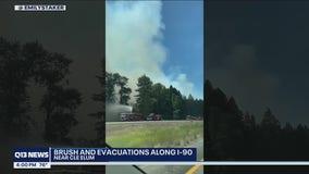 Brush fire and evacuations along I-90