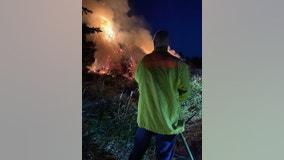 Firefighters battle large fire at Christmas tree farm in Auburn