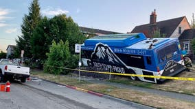 Tacoma transit bus crashes into front yard, at least one person sent to the hospital