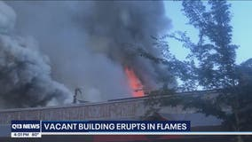 University District vacant building burns, police seek person of interest
