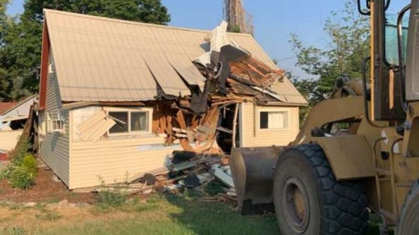 Police: Man drove through several counties in stolen school bus before crashing front-end loader into home