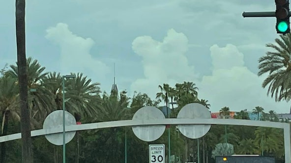 Florida woman spots Disney characters in clouds over theme park