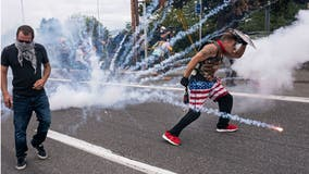 Protesters clash in Portland after opposing gatherings