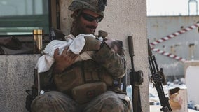 US military release pictures of soldiers helping Afghan families in Kabul