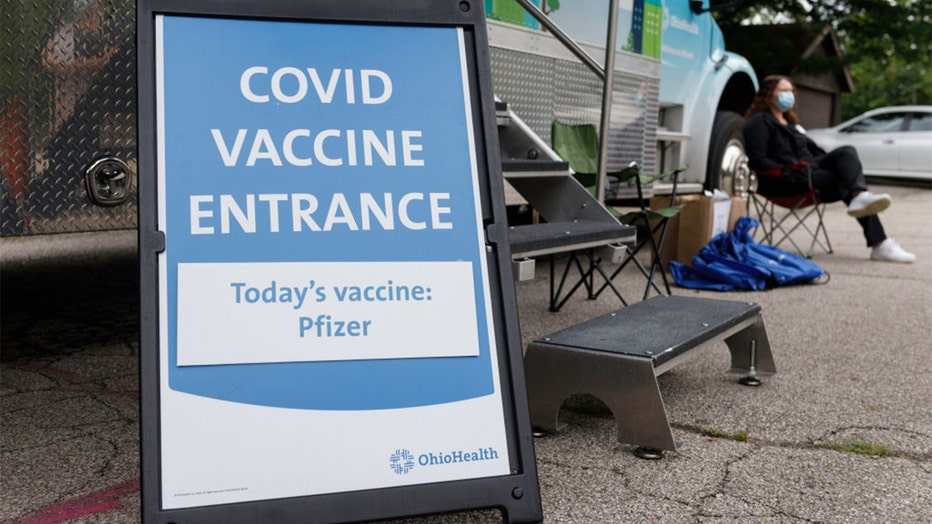 2d97d862-COVID vaccine sign