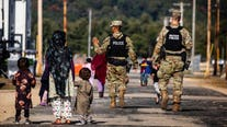 53,000 Afghan evacuees remain housed at 8 US military bases with more to arrive