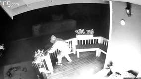 Video shows suspect dousing Enumclaw porch in flammable liquid before setting it on fire