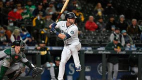 Haniger hits 2 HRs, M's beat A's to gain in wild-card race