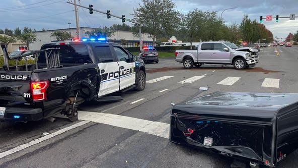 Puyallup Police officer hit by truck while responding to another crash