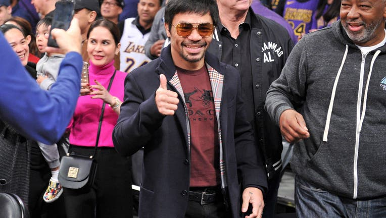 fcf59e53-Celebrities At The Los Angeles Lakers Game