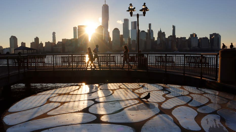 6641b953-Sunrise Behind Lower Manhattan in New York City