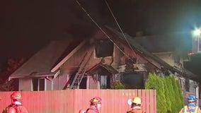 Crews tackle Tacoma house fire