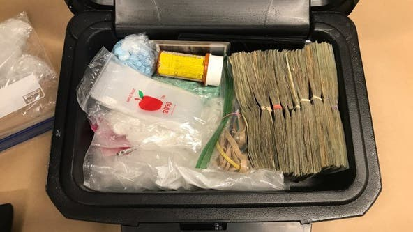 Guns, drugs, nearly $10,000 in cash recovered from stolen trailer