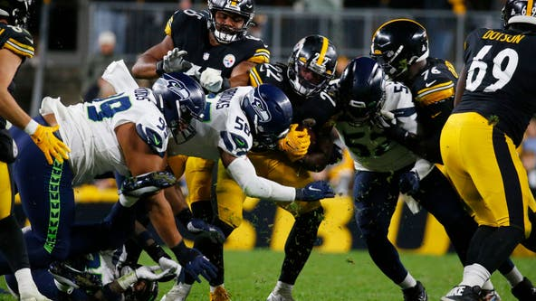Seahawks LB Darrell Taylor leaves game on stretcher