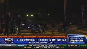 two hospitalized after dirt bike slams into car