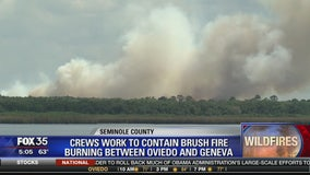 Crews work to contain brush fire burning between Oviedo and Geneva