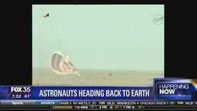 Astronauts land on earth