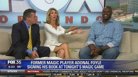 Former Magic Player Adonal Foyle signing his book at tonight's Magic game